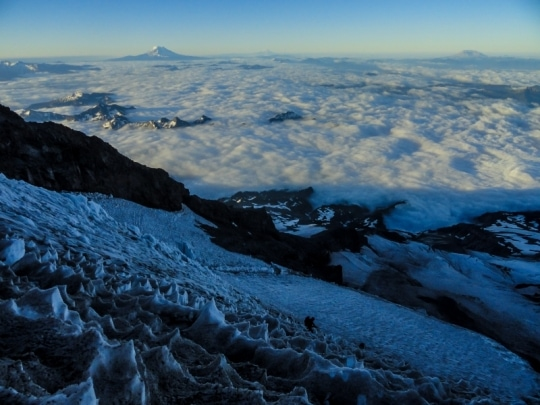 Above a sea of clouds at around 11k.