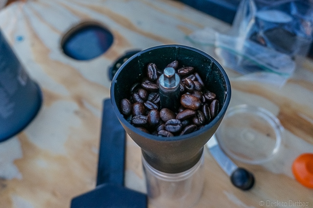 I use a hand cranked burr grinder, the Hario Mini Mill Slim Grind. A perfect companion for the Aeropress. The Best Camping Coffee Maker & How to Make Coffee While Camping