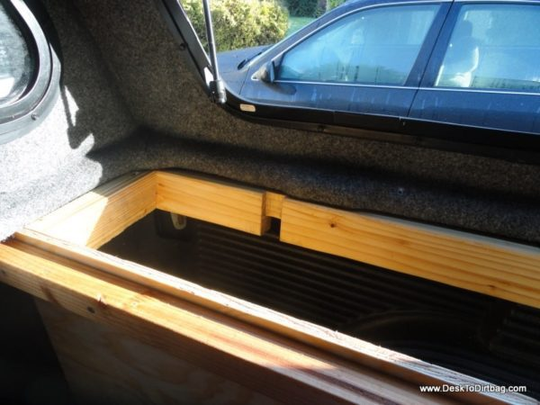 How the vertical side bins are attached to the truck--precisely notched out 2x4 where the canopy clamp goes.