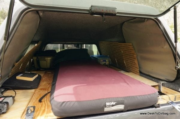 My sleep setup in the elevated position--things can be moved into the cab or positioned along side the mattress.