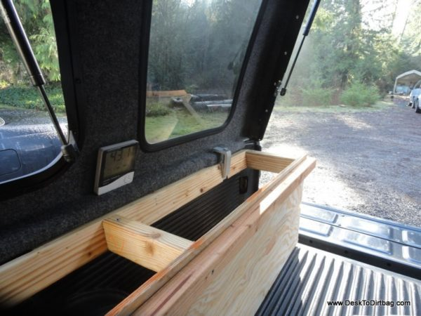 Vertical side bins--looking back toward the tailgate. TIP: Velcro can be used to attach things like the thermometer.