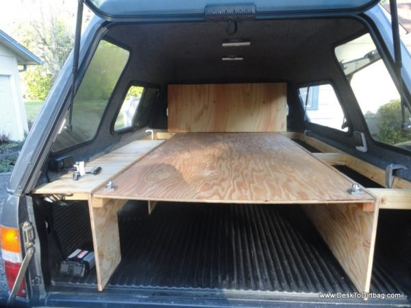 The large plywood board can be placed in the upper position for gear storage below and sleeping above. Tip: you don't need to lift up the back shelf to slide it into place. That was just for demonstration.