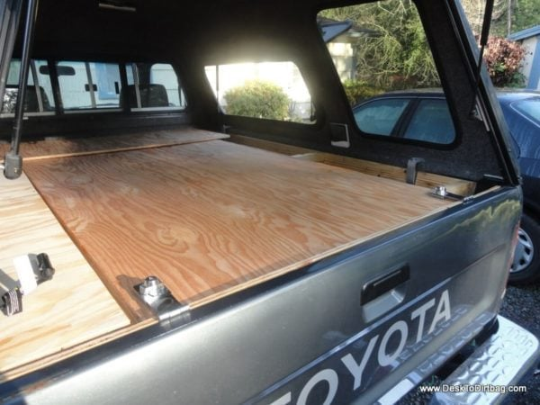 Tailgate locked on both sides to the large wooden platform, effectively preventing access to gear underneath.