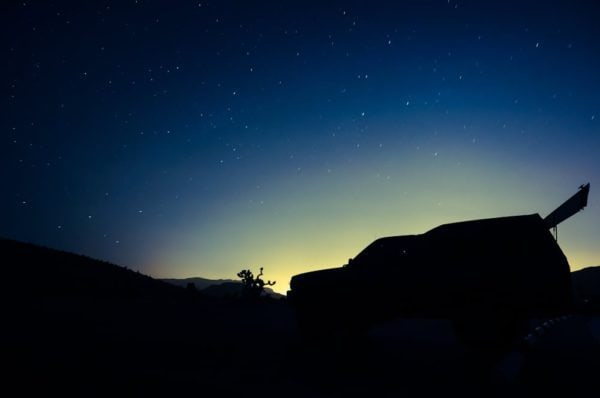 Camping under the stars with the glow of Las Vegas in the background.