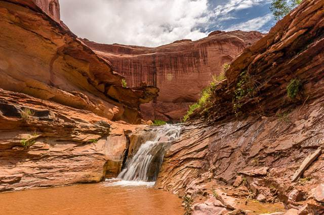 One of the numerous waterfalls along Coyote Gulch - Backpacking Coyote Gulch in Grand Staircase Escalante