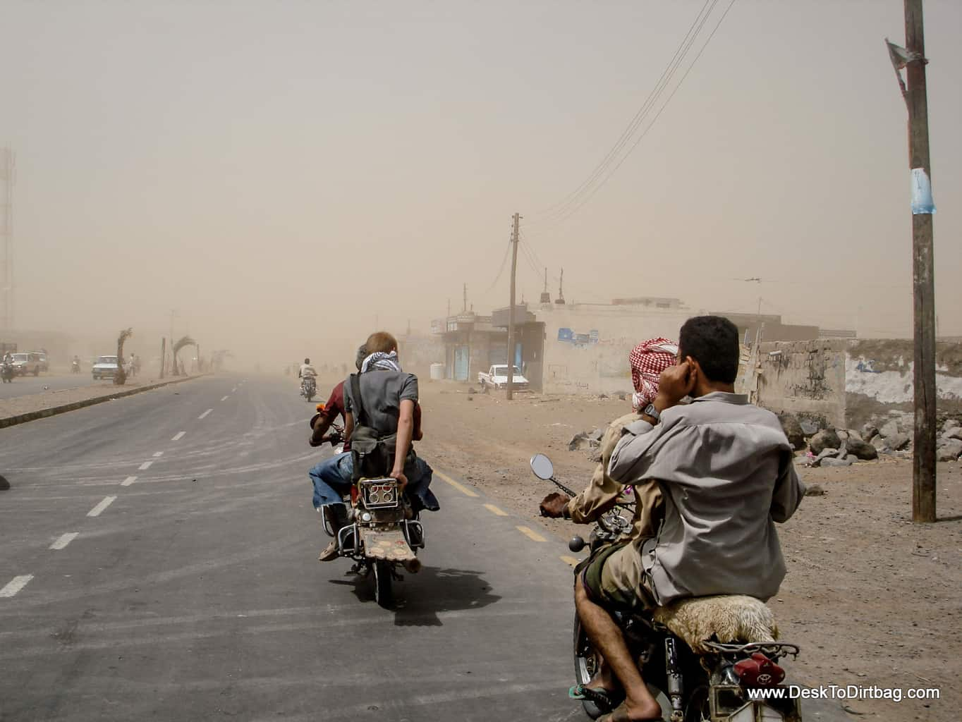 Riding into a sandstorm by motorbike in Mocha, Yemen.