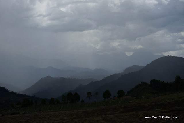 A rain storm descends upon the surrounding mountains.