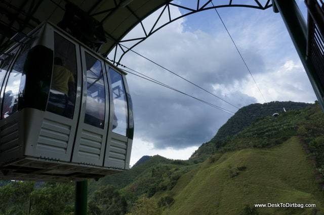 A cable car takes you to the top of a beautiful vista.