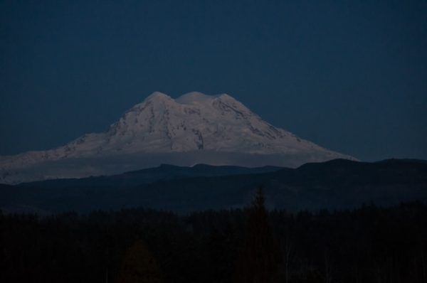 The three peaks of Mount Rainier viewed from the west.