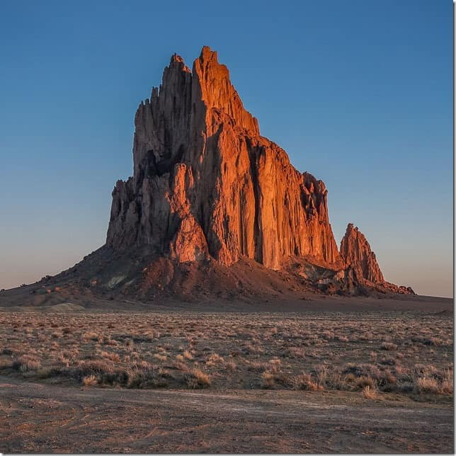 See Shiprock rise from the desert floor.