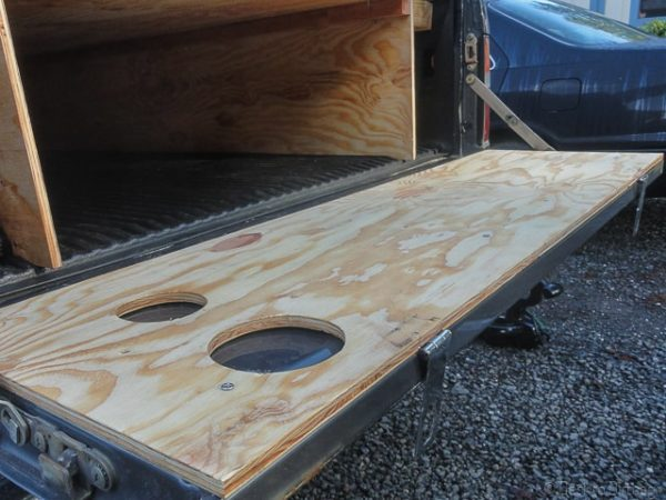 A flat wooden tailgate is a must for truck camping