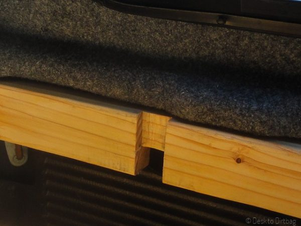 Notched out 2x4 where the clamp fits