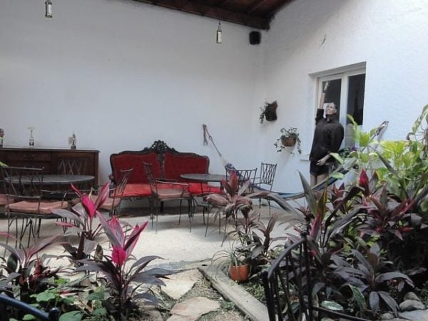 Outdoor courtyard in Colombia - how to travel the world on a budget