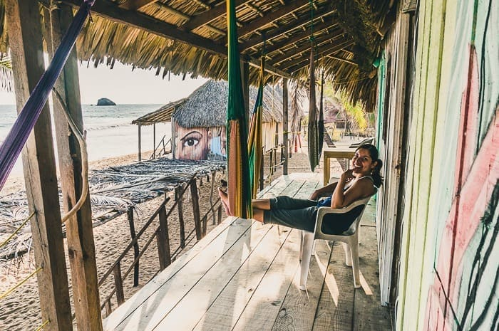 Andrea sitting back in our cabana overlooking the ocean in Zipolite, the coolest Mexico hippie beach town.