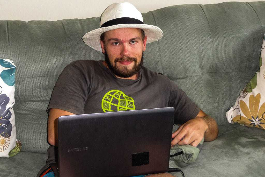 Hard at work on one of my many side hustle jobs, from the comfort of the couch in Panama (and with a Panama Hat, which are actually from Ecuador).