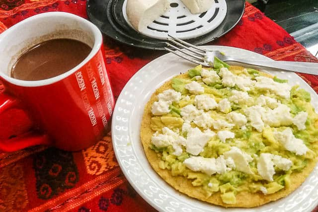Nescafe and an arepa with cheese and avocado - What to Eat in Colombia, a Guide to Colombian Food