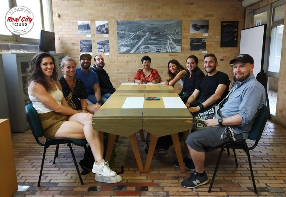 Meeting with social leaders on the Barrio Transformation tour in Moravia Medellin. These Moravia social tours are a great way to interact with locals and learn about their efforts.